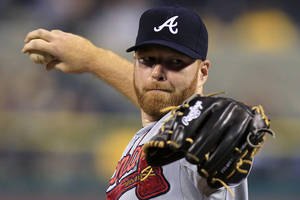 Photo -   Atlanta Braves starting pitcher Tommy Hanson delivers during the first inning of a baseball game against the Pittsburgh Pirates in Pittsburgh on Tuesday, Oct. 2, 2012. (AP Photo/Gene J. Puskar)