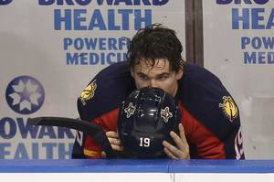 Photo -   Florida Panthers' Scottie Upshall sits on the bench after the New Jersey Devils defeated the Panthers 3-2 in two overtimes in Game 7 of a first-round NHL Stanley Cup playoff hockey series in Sunrise, Fla., Wednesday, April 26, 2012. (AP Photo/J Pat Carter)