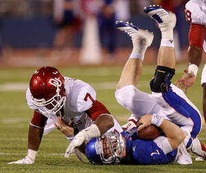 Photo - Oklahoma's Corey Nelson (7) brings down Kansas' Jordan Webb (2) during the college football game between the University of Oklahoma Sooners (OU) and the University of Kansas Jayhawks (KU) at Memorial Stadium in Lawrence, Kansas, Saturday, Oct. 15, 2011. Photo by Bryan Terry, The Oklahoman