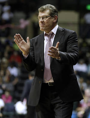 Photo - Connecticut head coach Geno Auriemma applauds during the second half of an NCAA college basketball game against South Florida, Sunday, Feb. 16, 2014, in Tampa, Fla. Connecticut won the game 63-38. (AP Photo/Chris O'Meara)