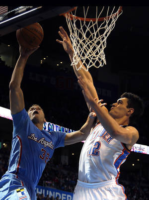 Photo -      The Los Angeles Clippers' Blake Griffin shoots over Oklahoma City's Steven Adams during their game on Feb. 23. Adams will now be counted on to step in for an injured Kendrick Perkins. PHOTO BY SARAH PHIPPS, The Oklahoman  <strong>SARAH PHIPPS -   </strong>