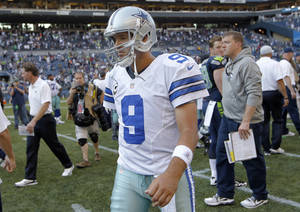 Photo - Dallas Cowboys quarterback Tony Romo (9) walks of the field after a 27-7 loss to the Seattle Seahawks in an NFL football game on Sunday, Sept. 16, 2012, in Seattle. (AP Photo/John Froschauer) ORG XMIT: SE133