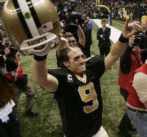 Photo - New Orleans Saints Drew Brees celebrates after their NFL football game against the New England Patriots, Monday, Nov. 30, 2009, in New Orleans. The Saints defeated the Patriots 38-17 to remain undefeated at 11-0. AP Photo