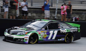 Photo - \Denny Hamlin drives on the back stretch during qualifying for the NASCAR Sprint Cup Series auto race, Friday, Aug. 23, 2013, in Bristol, Tenn. Hamlin won the pole. (AP Photo/Wade Payne)