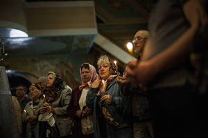 Photo - Mourners attend the funeral of 21-year old nurse Yulia Izotova in Kramatorsk, Ukraine, Monday, May 5, 2014. Witnesses say Izotova was killed by shots from a Ukrainian military column on the road near Kramatorsk. Ukraine sent an elite national guard unit to re-establish control Monday over the southern port of Odessa and government troops fought pitched gunbattles with a pro-Russia militia around an eastern city. (AP Photo/Manu Brabo)