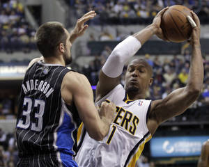 Photo -   Orlando Magic forward Ryan Anderson, left, defends Indiana Pacers forward David West in the second half of an NBA first-round playoff basketball game in Indianapolis, Saturday, April 28, 2012. The Magic defeated the Pacers 81-77. (AP Photo/Michael Conroy)
