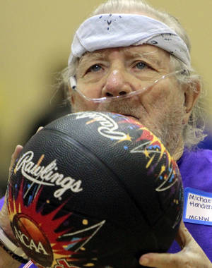 Photo - Michael Henderson, a resident at Manor Care Nursing Home in Oklahoma City, gets ready to shoot a basket.