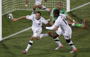 Photo - United States' Landon Donovan, front left, celebrates after scoring a goal with fellow team members during the World Cup group C soccer match between the United States and Algeria at the Loftus Versfeld Stadium in Pretoria, South Africa, Wednesday, June 23, 2010.  (AP Photo/Michael Sohn)