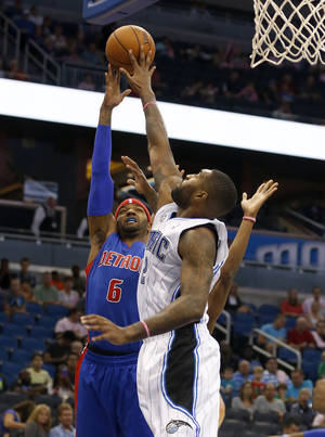 Photo - Detroit Pistons forward Josh Smith (6) shoots over Orlando Magic forward Kyle O'Quinn (2) during the first half of an NBA basketball game on Sunday,  Oct.  20, 2013, in Orlando, Fla. (AP Photo/Reinhold Matay)