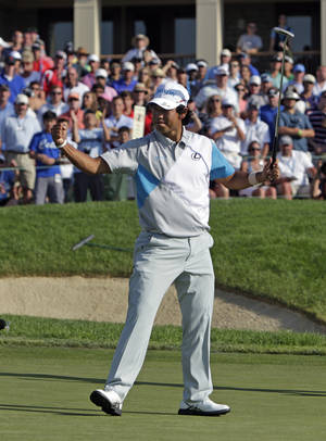 Photo - Hideki Matsuyama, of Japan, celebrates after winning the Memorial golf tournament in a playoff on Sunday, June 1, 2014, in Dublin, Ohio. (AP Photo/Jay LaPrete)