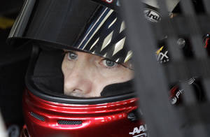 photo -   Driver Jeff Gordon looks from his car before practice for Saturday&#039;s NASCAR Bank of America 500 Sprint Cup series auto race in Concord, N.C., Friday, Oct. 12, 2012. (AP Photo/Chuck Burton)  