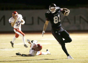 Photo - Scottsdale Desert Mountain wide receiver #81 Mark Andrews runs for a first down after breaking a tackle by Mesa Mountain View's Connor Ipsen played at Desert Mountain High School in Scottsdale, AZ. PHOTO COURTESY ARIZONA REPUBLIC <strong>Rob Schumacher</strong>
