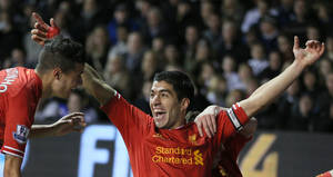 Photo - Liverpool's Luis Suarez celebrates after scoring the opening goal during the English Premier League soccer match between Tottenham Hotspur and Liverpool at the White Hart Lane stadium in London, Sunday, Dec  15  2013. Liverpool won the game 5-0. (AP Photo/Alastair Grant)