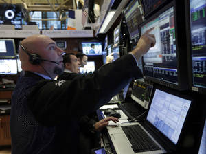 photo - Traders work in their booth on the floor of the New York Stock Exchange Friday, March 8, 2013. Stocks are opening higher on Wall Street after the government reported a burst of hiring last month that sent the unemployment rate to a four-year low. (AP Photo/Richard Drew)
