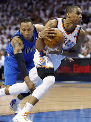 Photo -   Oklahoma City Thunder guard Russell Westbrook, right, is fouled by Dallas Mavericks forward Shawn Marion, left, as he drives to the basket in the second quarter of Game 2 in the first round of the NBA basketball playoffs, in Oklahoma City, Monday, April 30, 2012. (AP Photo/Sue Ogrocki)