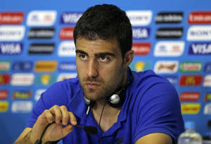 Photo - Greece's Sokratis Papastathopoulos speaks during a press conference of Greece in Natal, Brazil, Wednesday, June 18, 2014.  Greece play in group C of the 2014 soccer World Cup. (AP Photo/Shuji Kajiyama)