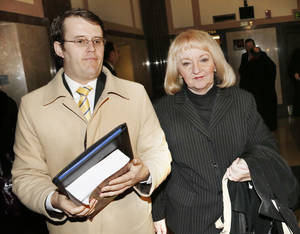 Photo - Former state Sen. Debbe Leftwich leaves Thursday with attorney Travis Jett after being sentenced at the Oklahoma County Courthouse to one year on probation in her political bribery case.  <strong>Steve Gooch</strong>