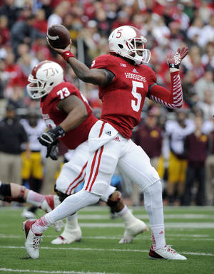 Photo - Indiana's Tre Roberson (5) throws during the first half of an NCAA college football game against Minnesota in Bloomington, Ind., Saturday, Nov. 2, 2013. (AP Photo/ Alan Petersime)