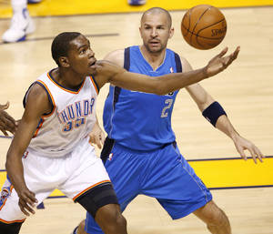 photo - Oklahoma City&#039;s Kevin Durant (35) grabs the ball in front of Jason Kidd (2) of Dallas during game 4 of the Western Conference Finals in the NBA basketball playoffs between the Dallas Mavericks and the Oklahoma City Thunder at the Oklahoma City Arena in downtown Oklahoma City, Monday, May 23, 2011. Photo by Bryan Terry, The Oklahoman