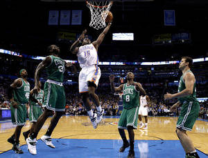 Photo - Oklahoma City's Reggie Jackson (15) goes up for a basket as through a host of Boston defenders over during the NBA game between the Oklahoma City Thunder and the Boston Celtics at the Chesapeake Energy Arena., Sunday, Jan. 5, 2014. Photo by Sarah Phipps, The Oklahoman