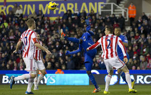 photo - Chelsea's Demba Ba, center, controls the ball as Stoke City's Ryan Shawcross, left, and Geoff Cameron look on during their English Premier League soccer match at the Britannia Stadium, Stoke, England, Saturday Jan. 12, 2013. (AP Photo/Jon Super)