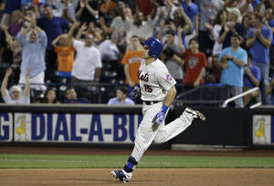Photo - New York Mets' Travis d'Arnaud (15) rounds the bases after hitting a two-run home run against the Atlanta Braves in the seventh inning of a baseball game, Wednesday, July 9, 2014, in New York. (AP Photo/Julie Jacobson)