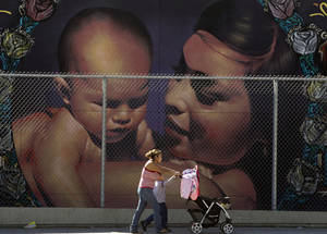photo - A mother walks with her children to the MacArthur Park Primary Center School in Los Angeles Thursday, Jan. 31, 2013. Within six months, California's Hispanic population will equal that of whites and soon after will surpass it, a milestone in the country's shifting demographics. Population projections to be released Thursday by the state Department of Finance show that Hispanics will become the dominant ethnic group in California for the first time since it gained statehood during the Gold Rush era. (AP Photo/Damian Dovarganes)
