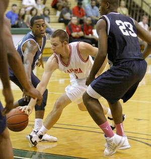 photo - Rhett Radcliff of the Oklahoma team goes between Je'Lon Hornbeak, left, and Brandon Conley of the Texas team during the Faith 7 Basketball Bowl at Oklahoma Baptist University in Shawnee, Okla., Sat., June 9, 2012. Photo by Bryan Terry, The Oklahoman