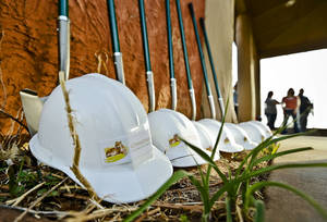 Photo - Hard hats and shovels are lined up to use during the groundbreaking for the Oklahoma City Zoo's new Joan Kirkpatrick Animal Hospital.