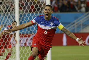 Photo - United States' Clint Dempsey celebrates after scoring the opening goal during the group G World Cup soccer match between Ghana and the United States at the Arena das Dunas in Natal, Brazil, Monday, June 16, 2014. The United States won the match 2-1. (AP Photo/Ricardo Mazalan)
