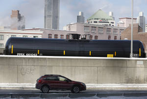 Photo - A railroad oil tanker car is parked along Interstate 787 in downtown Albany, N.Y., on Friday, Feb. 7, 2014. The Port of Albany has become a hub for the U.S. oil business, taking shipments from North Dakota's Bakken Shale daily by mile-long trains and shipping it in tankers down the Hudson River to refineries. Opponents of a proposal to build boilers to liquefy heavy crude passing through Albany by rail are drawing attention to the capital's emergence as a major hub for the transport of oil that's widely considered risky from an environmental and safety standpoint.  (AP Photo/Mike Groll)