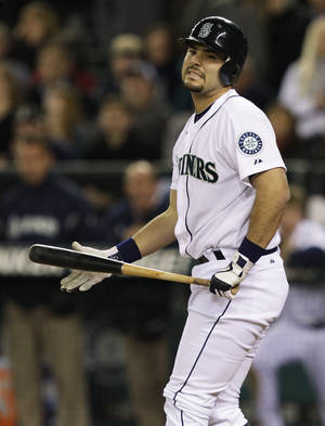 Photo -   Seattle Mariners' Jesus Montero reacts to a pitch in the ninth inning of a baseball game against the Detroit Tigers, Tuesday, May 8, 2012, in Seattle. The Tigers beat the Mariners, 6-4. (AP Photo/Ted S. Warren)