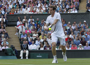 Photo - Andy Murray of Britain plays a return to Roberto Bautista Agut of Spain during their men's singles match at the All England Lawn Tennis Championships in Wimbledon, London, Friday June 27, 2014. (AP Photo/Ben Curtis)