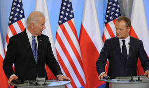 Photo - U.S. Vice President Joe Biden, left, and Polish Prime Minister Donald Tusk look at each others during a press conference after talks in Warsaw, Poland, Tuesday, March 18, 2014. Biden arrived in Warsaw for consultations with Prime Minister Donald Tusk and President Bronislaw Komorowski, a few hours after Russian President Vladimir Putin approved a draft bill for the annexation of Crimea, one of a flurry of steps to formally take over the Black Sea peninsula. (AP Photo/Alik Keplicz)