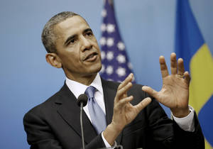 Photo - President Barack Obama gestures as he answers questions during a joint news conference with Swedish Prime Minister Fredrik Reinfeldt, Wednesday, Sept. 4, 2013, at the Rosenbad Building in Stockholm, Sweden. (AP Photo/Pablo Martinez Monsivais)