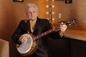 Photo - FILE - In this March 11, 2011 file photo Ralph Stanley poses for a photo backstage at the Grand Ole Opry House in Nashville, Tenn. Stanley, the last of the original bluegrass legends arrives Saturday, June 14, 2014, at the Huck Finn Jubilee in Ontario for a rare Southern California appearance that was to be part of a farewell tour, that was until he put his retirement on hold. (AP Photo/Ed Rode, File)