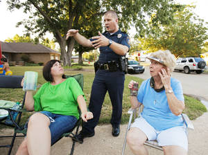 photo - Norman police Lt. Shawn Hawkins talks about crime prevention with residents on Homeland Avenue at last year's National Night Out event.
