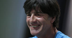 Photo - German national soccer team head coach Joachim Loew laughs during a news conference in Santo Andre near Porto Seguro, Brazil, Thursday, June 12, 2014. Germany will play in group G of the 2014 soccer World Cup. (AP Photo/Matthias Schrader)