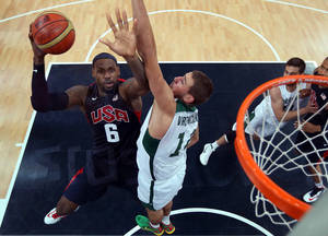 Photo -   United States' LeBron James (6) shoots against Lithuania during their men's preliminary round basketball game at the 2012 Summer Olympics on Saturday, Aug. 4, 2012, in London. (AP Photo/Christian Petersen, Pool)