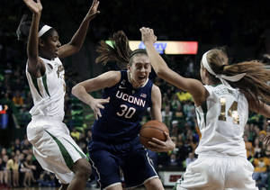 Photo - Baylor center Khadijiah Cave, left, and guard Makenzie Robertson (14) attempt to stop a drive to the basket by Connecticut's Breanna Stewart (30) in the first half of an NCAA college basketball game, Monday, Jan. 13, 2014, in Waco, Texas. (AP Photo/Tony Gutierrez)