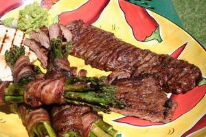photo - Fajitas and bacon-wrapped asparagus are great on the grill and sure to please at your tailgate. <strong> - THE OKLAHOMAN</strong>