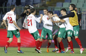 Photo -   Bulgaria's Georgi Milanov, center, celebrates after scoring during a Group B 2014 World Cup qualifying match against Italy, at the Vassil Levski stadium in Sofia, Friday, Sept. 7, 2012. (AP Photo/Oleg Popov)