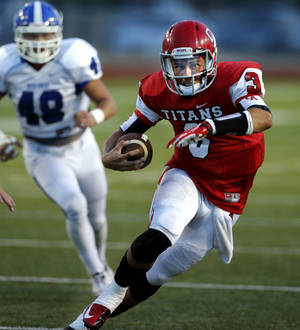 Photo - Carl Albert's Stevie Thompson carries during a high school football game between the Carl Albert Titans and the Deer Creek Antlers on Friday, Sept. 27, 2013 in Midwest City, Okla. Photo by Steve Sisney, The Oklahoman