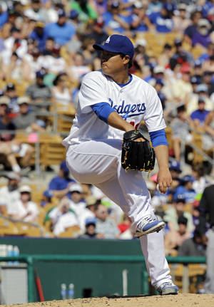 Photo - Los Angeles Dodgers starting pitcher Hyun-Jin Ryu delivers against the Colorado Rockies in the fifth inning of a spring exhibition baseball game on Sunday, March 16, 2014, in Glendale, Ariz. (AP Photo/Mark Duncan)