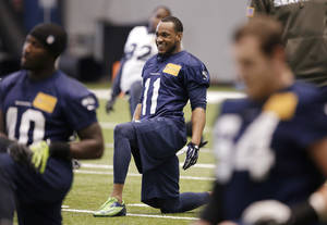 Photo - Seattle Seahawks' Percy Harvin (11) smiles as he stretches during NFL football practice Tuesday, Jan. 7, 2014, in Kirkland, Wash. The Seahawks host the New Orleans Saints on Saturday in an NFC divisional playoff game. (AP Photo/Elaine Thompson)