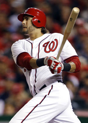photo - FILE - In this Oct. 12, 2012, file photo, Washington Nationals' Michael Morse watches his two-run home run in the third inning of Game 5 of the National League division baseball series against the St. Louis Cardinals in Washington. The Nationals traded power-hitting Morse to Seattle on Wednesday, Jan. 16, 2013, in a three-team deal that moved catcher John Jaso from the Mariners to the Oakland Athletics. (AP Photo/Pablo Martinez Monsivais, File)