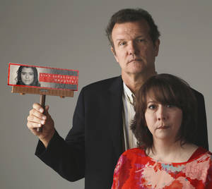 "Photo - Tammy Stauffer and Steve Siler holds a billboard replica from the ""She's somebody's daughter"" anti-pornography campaign at OPUBCO studio Monday, October 3, 2013. Photo by Doug Hoke, The Oklahoman"