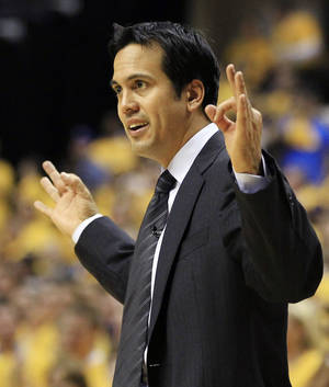 Photo -   Miami Heat head coach Erik Spoelstra argues a call during the second half of Game 3 of their NBA basketball Eastern Conference semifinal playoff series against the Indiana Pacers, Thursday, May 17, 2012, in Indianapolis. Indiana won 94-75. (AP Photo/Darron Cummings)