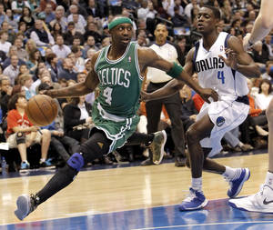 photo - Boston Celtics' guard Jason Terry, left, drives past Dallas Mavericks' guard Darren Collison during the first half of an NBA basketball game on Friday, March 22, 2013, in Dallas. (AP Photo/Brandon Wade)