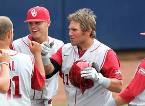 photo - Oklahoma outfielder Cody Reine (11) celebrates a three-run homer in the seventh inning with teammates Tanner Toal (31) and Caleb Bushyhead (5) during an NCAA college baseball tournament regional game against Appalachian State, Monday, June 4, 2012 at Davenport Field in Charlottesville, Va. Oklahoma defeated Appalachian State 14-6. (AP Photo/Andrew Shurtleff) ORG XMIT: VAAS110